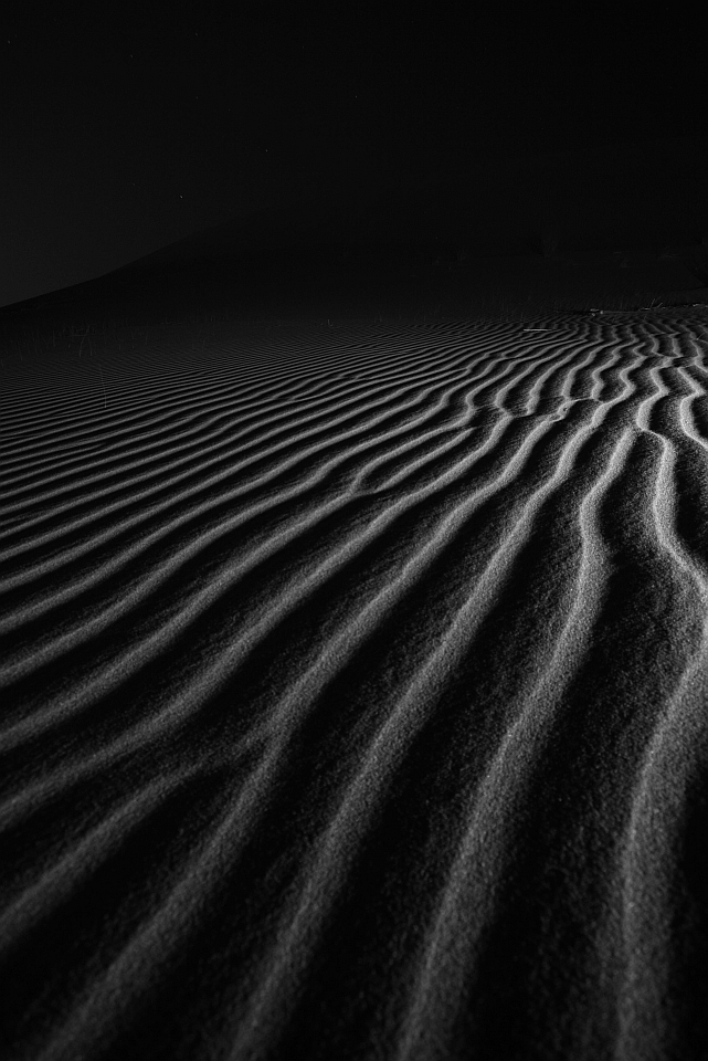 desert ripples on a dune at night in the UAE