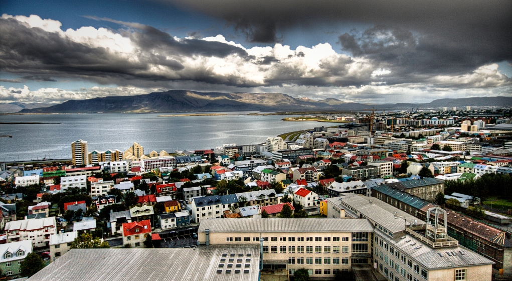 A panoramic shot of Reykjavik the capital of Iceland from the top of a church tower on a cloudy day