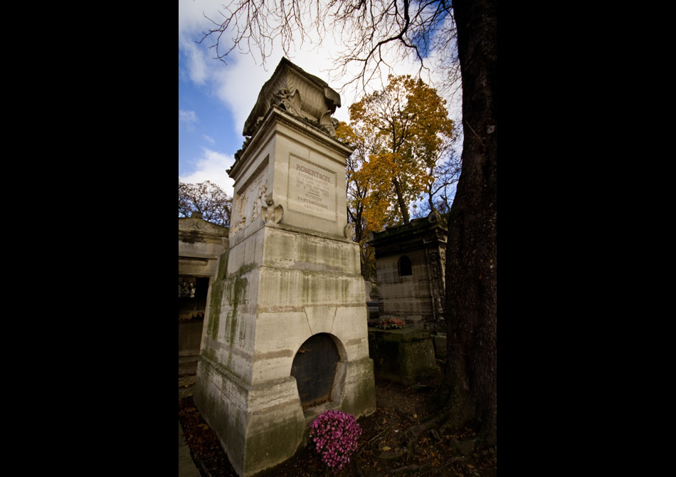 rich tombs and monuments along old crumbling tombstones in the pere lachaise cemetery in paris