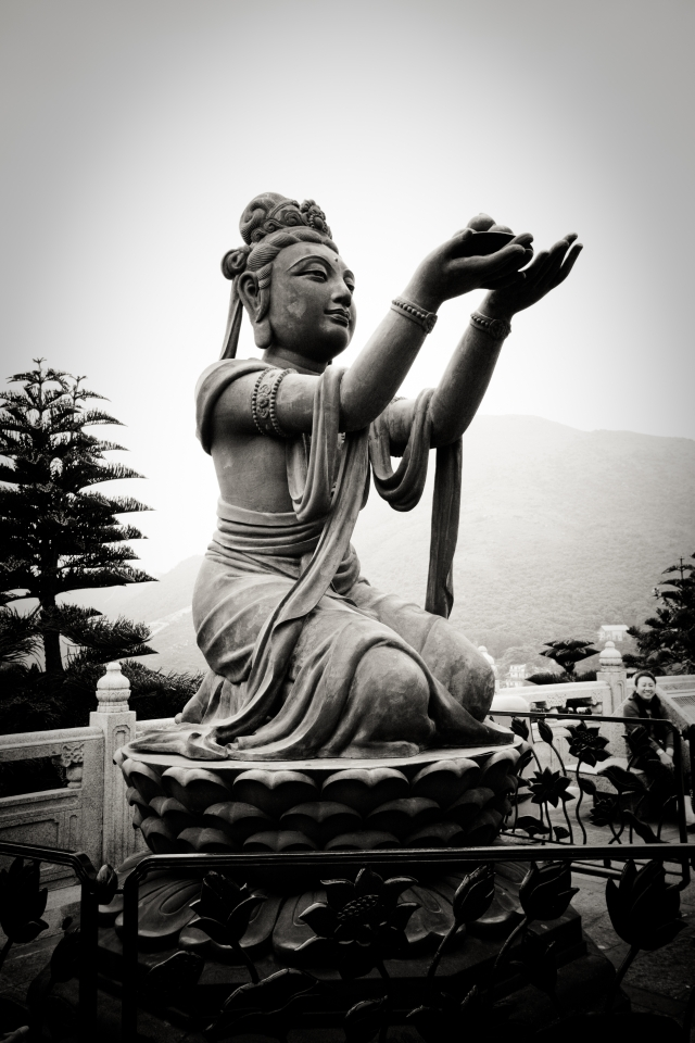 The statue of a deva offering fruits to Tian Tan Buddha on Lantau Island in Hong Kong