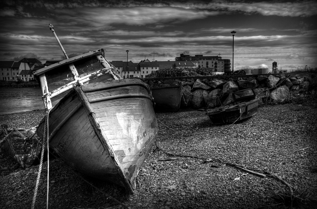 Ships stranded on the shore on the Galway port in Ireland
