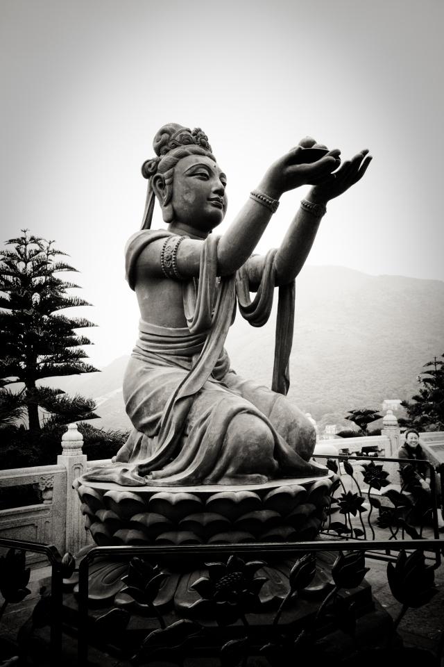 The statue of a deva offering fruits to Tian Tan Buddha on Lantau Island in Hong Kong