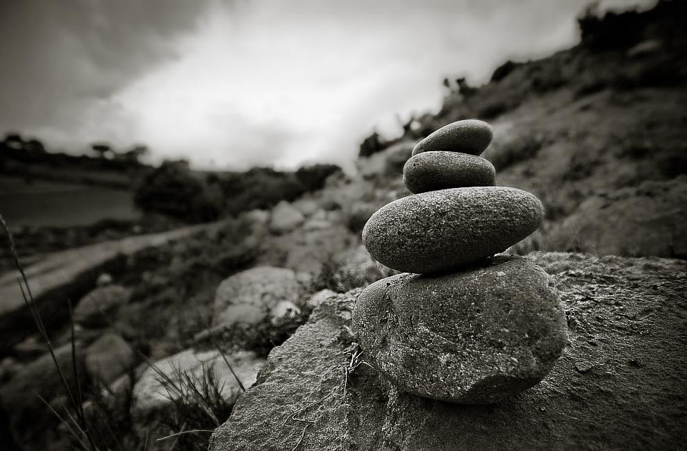 A garden of small pebble cairns on the camino de santiago near ventosa in Spain.