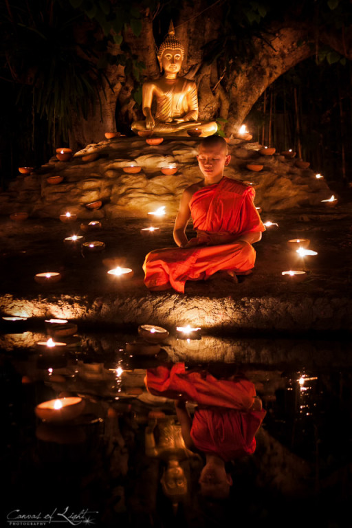 A Young Monk Meditating during Visakha Bucha festival in Chiang Mai - Thailand